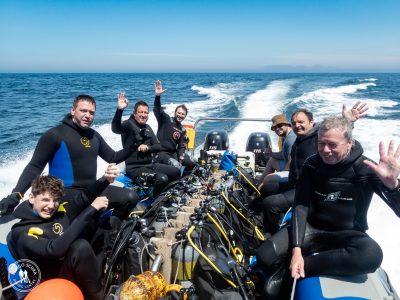 Happy divers on Indigo Scuba's boat